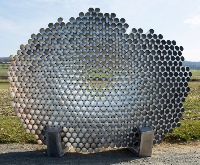 large aluminum sculpture installed outdoors