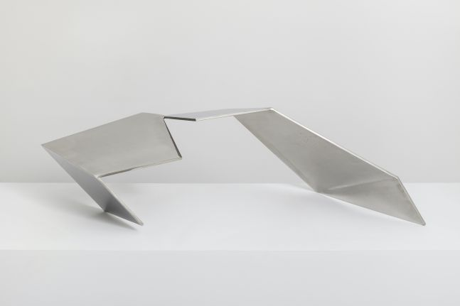 Angular, reflective, and sharp stainless steel sculpture by Beverley Pepper.