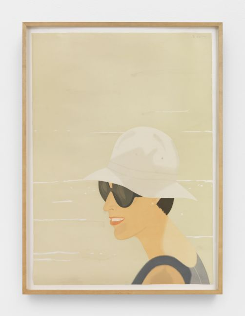 Framed color aquatint by Alex Katz of a smiling woman wearing a tan bucket and sunglasses against a sandy background
