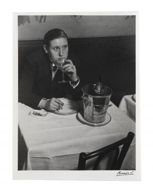 Black and white photographic portrait of woman dressed as a man at Le Monocle, Paris.
