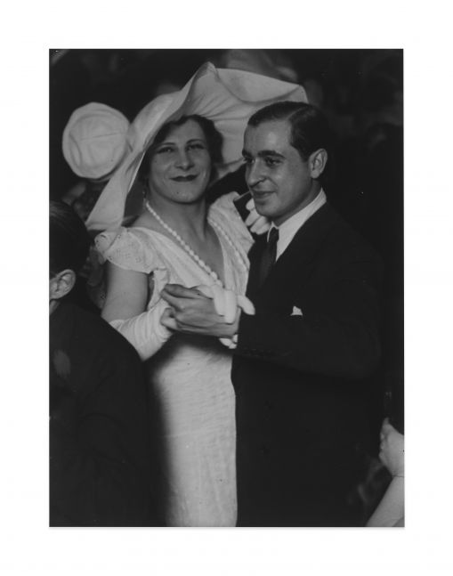 Black and white photographic portrait of homosexual couple at the Magic City Ball, Paris