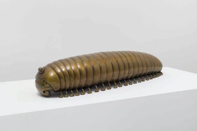 Bronze sculpture of millipede with top hat by Tom Otterness.