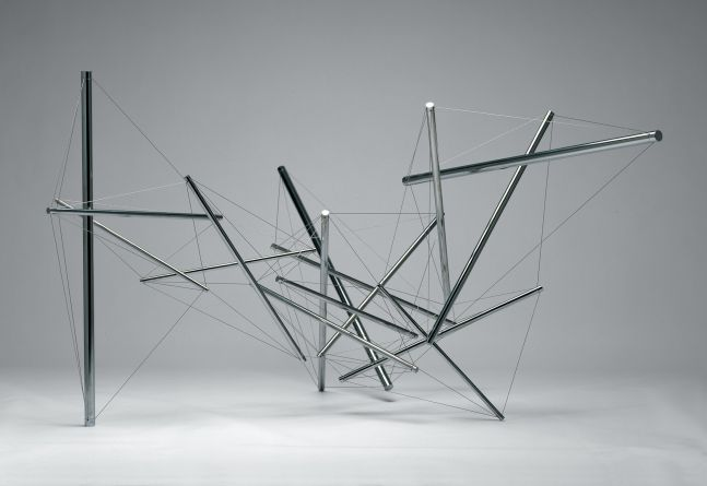 Web of stainless steel cylinders held together with wire.