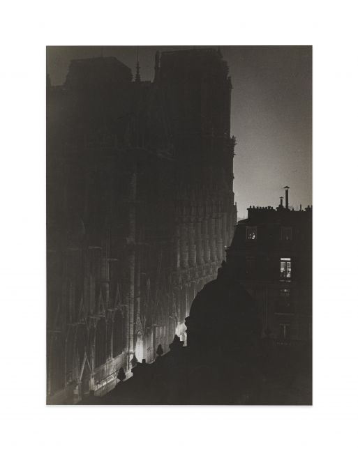 Black and white high gloss print of a shadowy Notre-Dame.