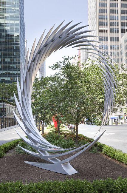 An installation shot of Santiago Calatrava's sharp, reflective and angular stainless steel sculpture sits atop pedestal on Park Avenue.