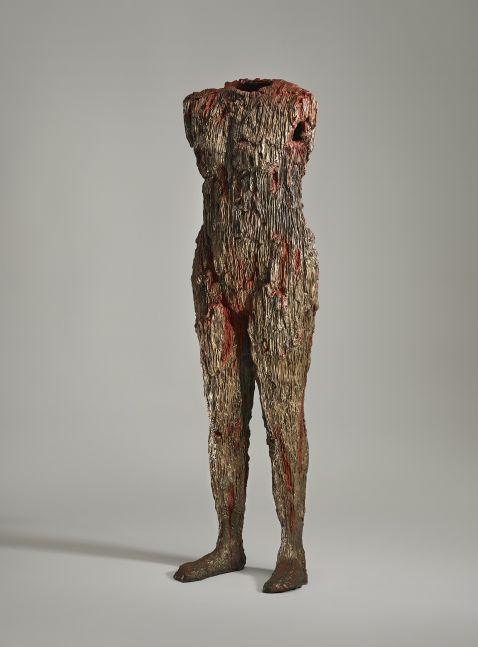 Cast bronze sculpture resembling human body with red and gold hues by Michele Oka Doner.