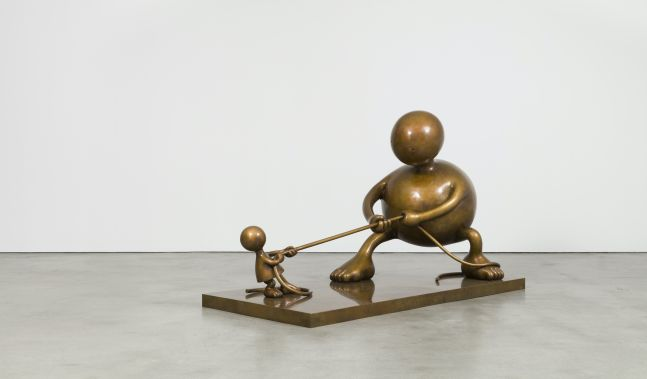 Bronze sculptures depicting two rotund figures playing tug of war by Tom Otterness.