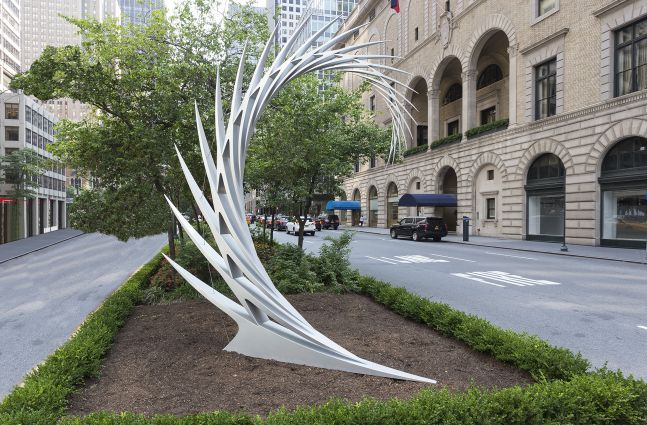 An installation shot of Santiago Calatrava's sharp, reflective and angular stainless steel sculpture sits atop pedestal on Park Avenue.