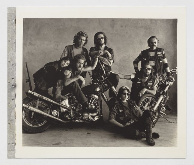 Black and white group photograph of motorcyclists.