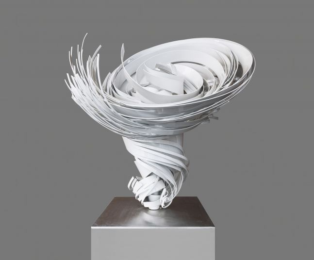 White powder coated aluminum sculpture of a small twist by Alice Aycock