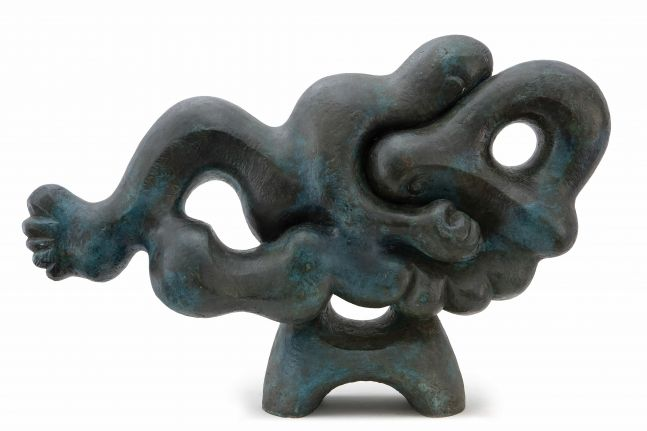 Abstract bronze statue with humanlike extremities.