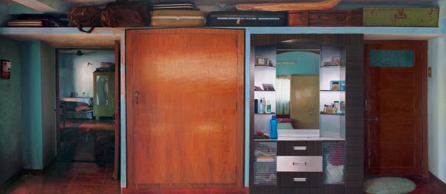 ABIR KARMAKAR Home (Wall V), 2016  Oil on canvas, interior look of domestic household, cupboard, large wooden door, suitcases sacked