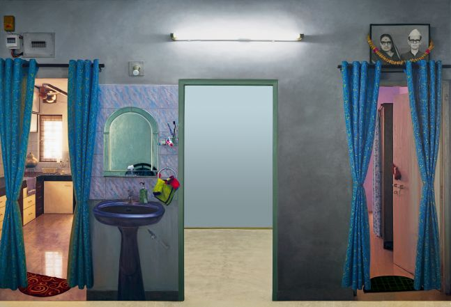 ABIR KARMAKAR Displacement (Wall I), 2017  Oil on canvas, kitchen counters, blue curtains, wash basin, white florescent tube light, black and white picture of old couple with garland on wall, mirror, switch board