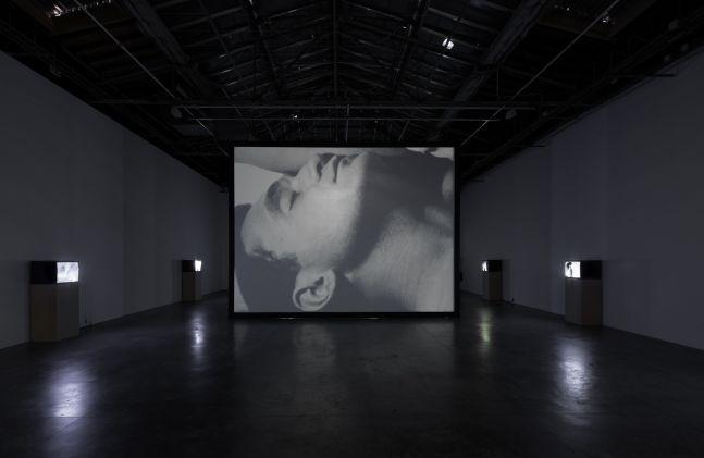 John Giorno in Andy Warhol's Sleep for I ♥ John Giorno, Palais de Tokyo, 2015