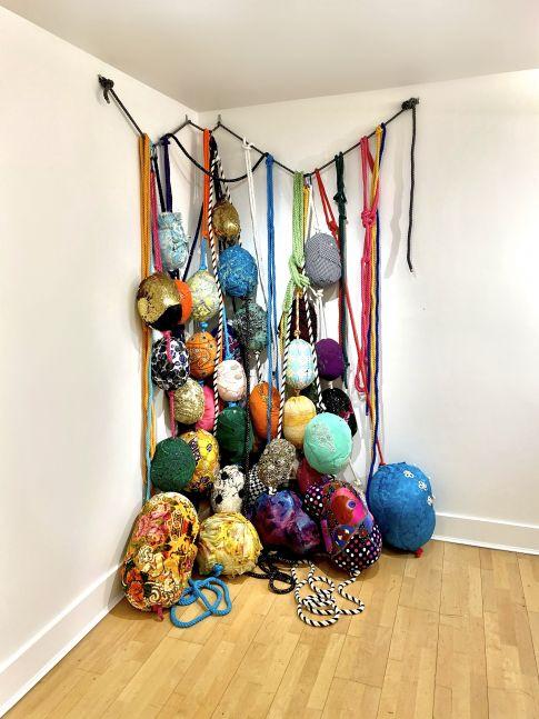 Rebecca Segall, Gunas (Installation)  8' x 4' x 3'  Found Textiles, Embroidery Thread, Plastic, Tape, Batting, Cotton Rope