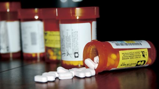 overturned prescription painkiller bottle that can result in a drug overdose