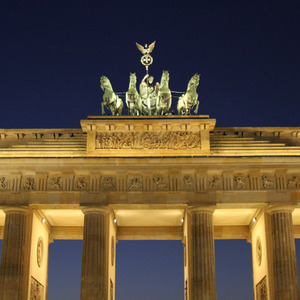 Brandenburg Gate at night with statue of Victory