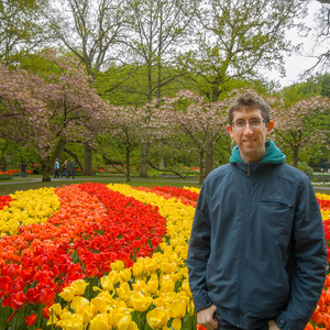 Me with orange, yellow, and red tulips