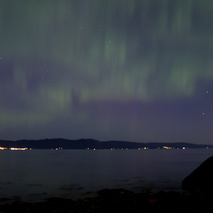 Northern lights over the water