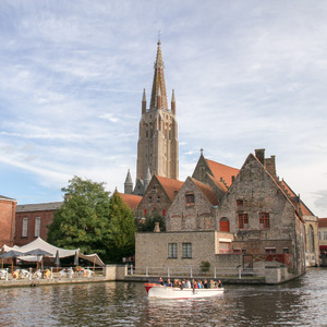 Old Saint-John and Church of Our Lady on a canal in Bruges