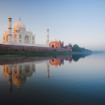 A beautiful sunrise lights the side of the Taj Mahal as seen from the Jamuna River.