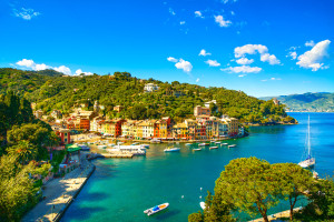 Portofino luxury landmark aerial panoramic view. Village and yacht in little bay harbor. Liguria, Italy