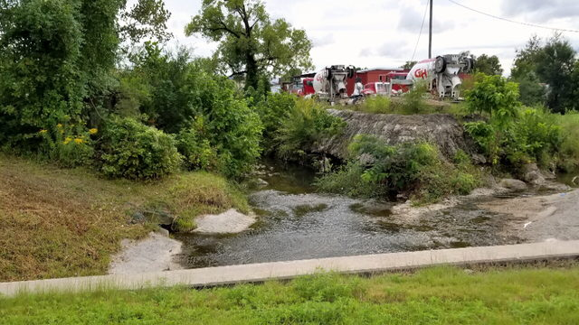 Crews investigate oily substance along Joplin Creek