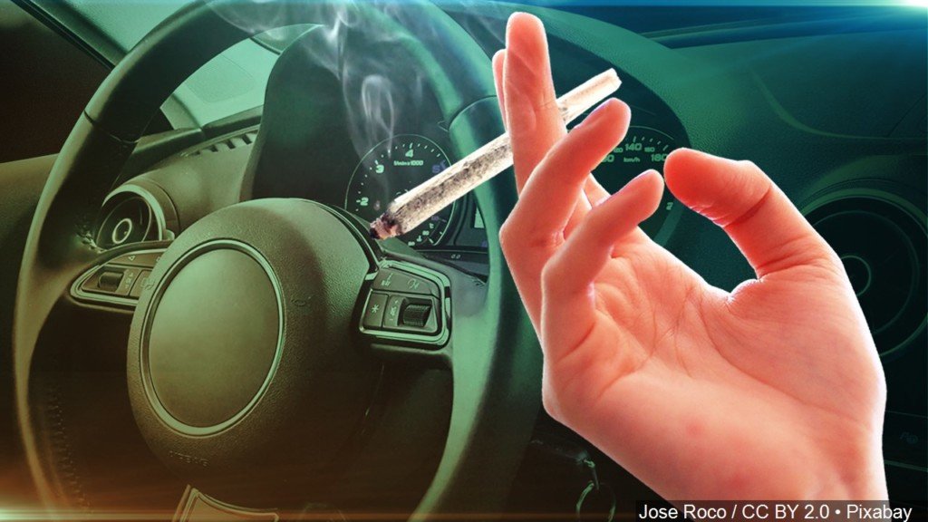 Marijuana joint and vehicle steering wheel