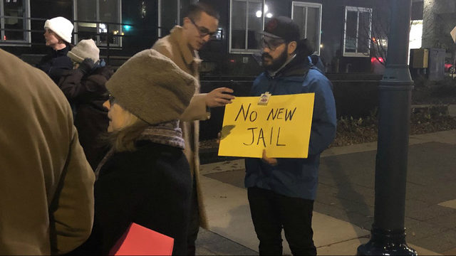 Board votes to pass county budgets despite 40-minute chant to 'derail the jail'