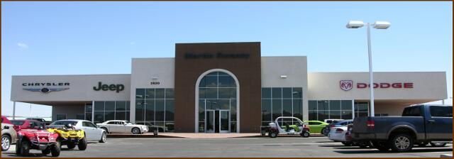 MARTIN SWANTY CHRYSLER DODGE - Kingman, AZ. New car dealership with 7,286 sq ft of show room and offices, 6,733 sq ft of service bays and 1,924 sq ft of exterior covered display area.