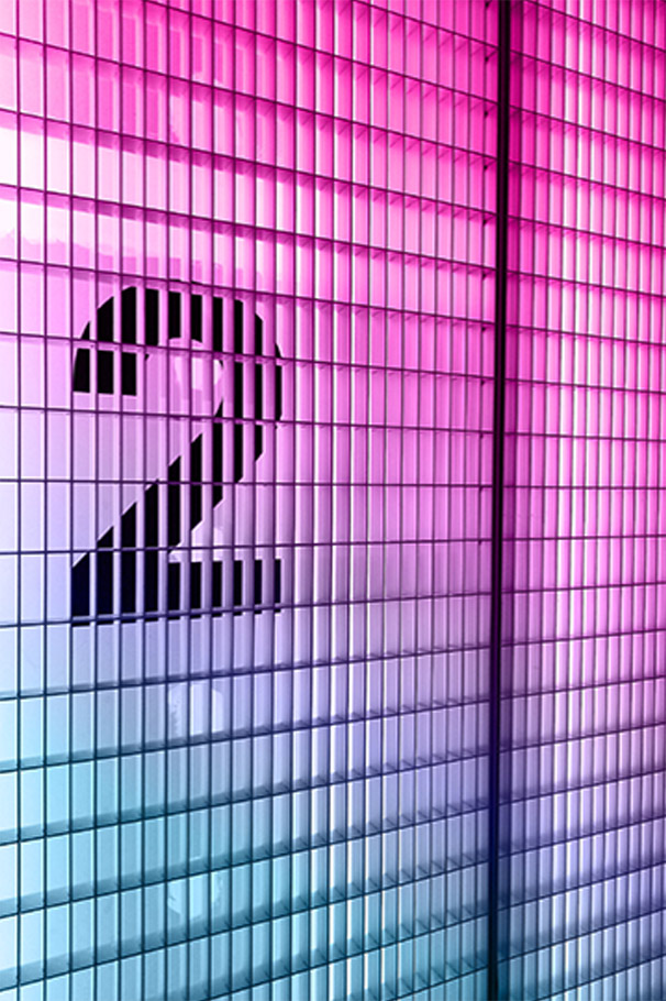 Neon lights with the number 2 behind a grate, blue to pink