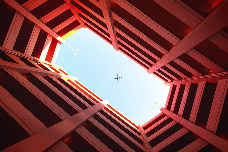 Picture from the ground of a plane flying overhead.