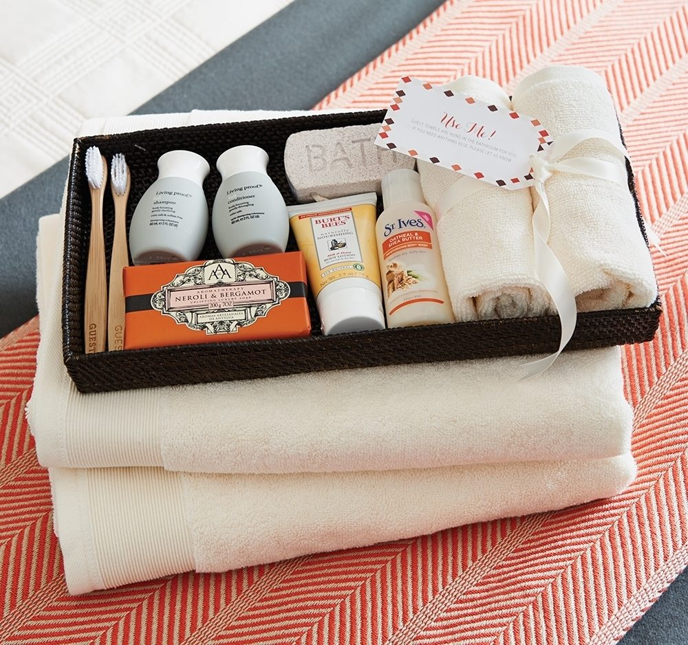 a tray of towels and toiletries for guests