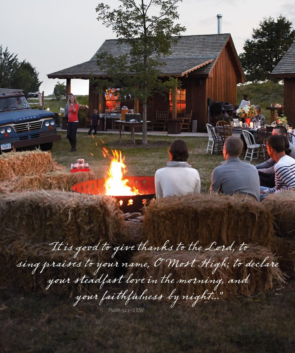 A photo of guests gathering around a fire pit at a casual outdoor fall party with the Bible verse Psalm 92:1-2.