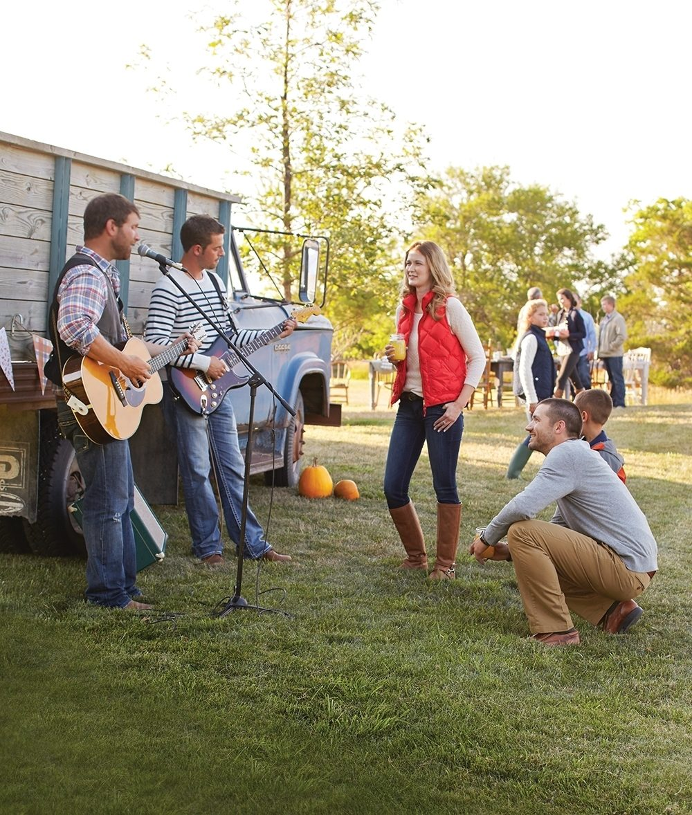 Musician friends get the casual outdoor fall part started midafternoon.