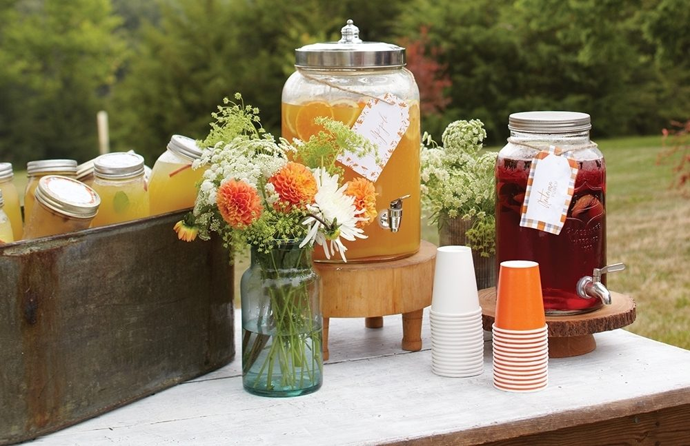 During the afternoon, a small table near a cabin offers self-serve cold drinks such as juice, punch and individual canning jars filled with iced coffee.