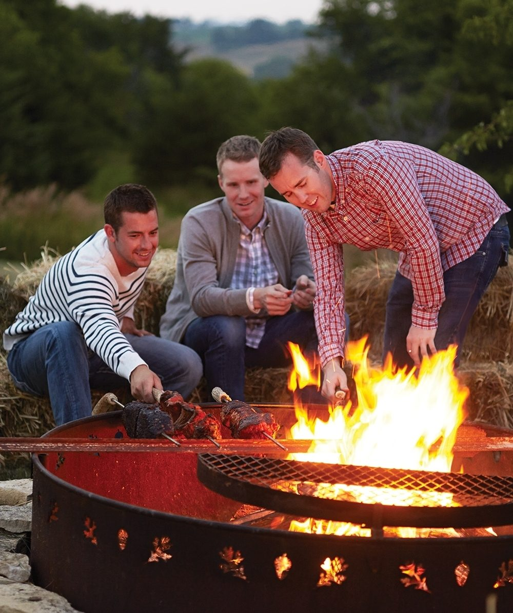 Whole pork loins, beef briskets and individual cuts of meat are threaded onto long steel rods and cooked Brazilian-style over an open flame for a casual outdoor fall party.