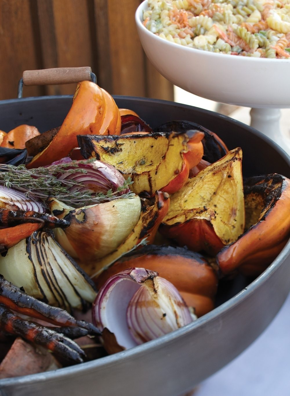 Whole and chunked root vegetables were cooked on grates over a fire for a casual outdoor fall party.