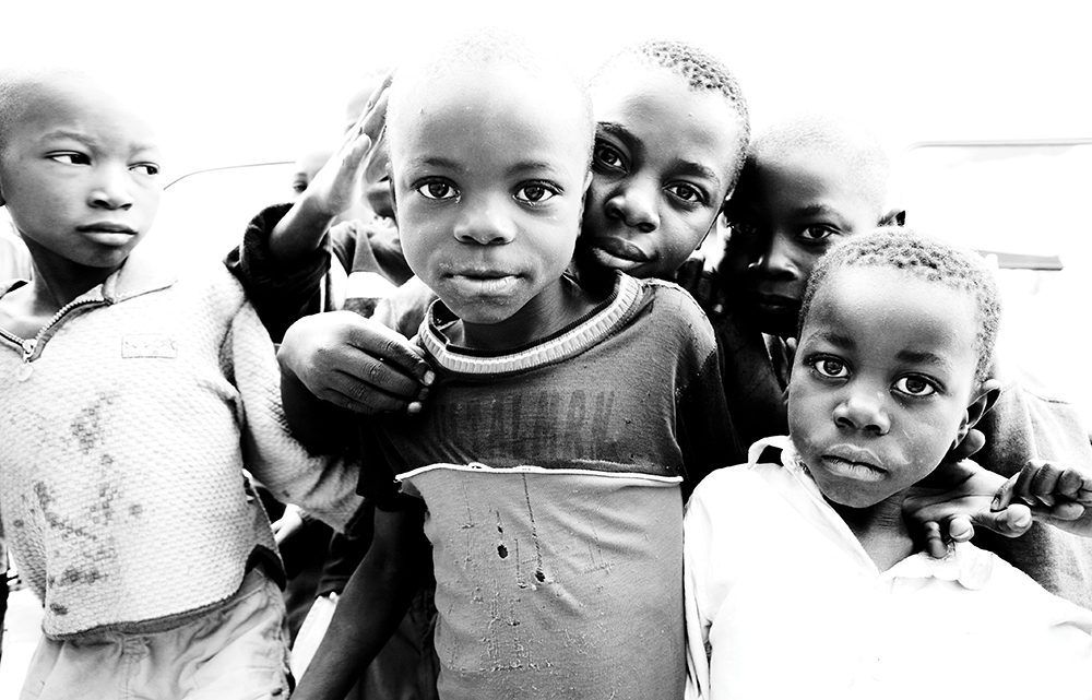 A few of the children who have been helped by Sole Hope's efforts in Uganda. The nonprofit has put nearly 2,500 pairs of shoes on children's feet in the country.