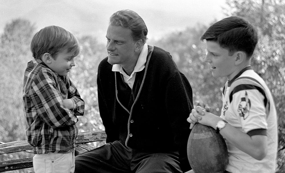 As a young father, Billy takes a moment with sons, Ned, left, and Franklin, right.