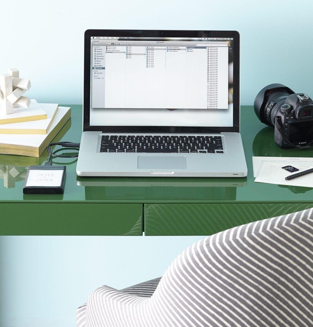 Laptop computer on a green desk