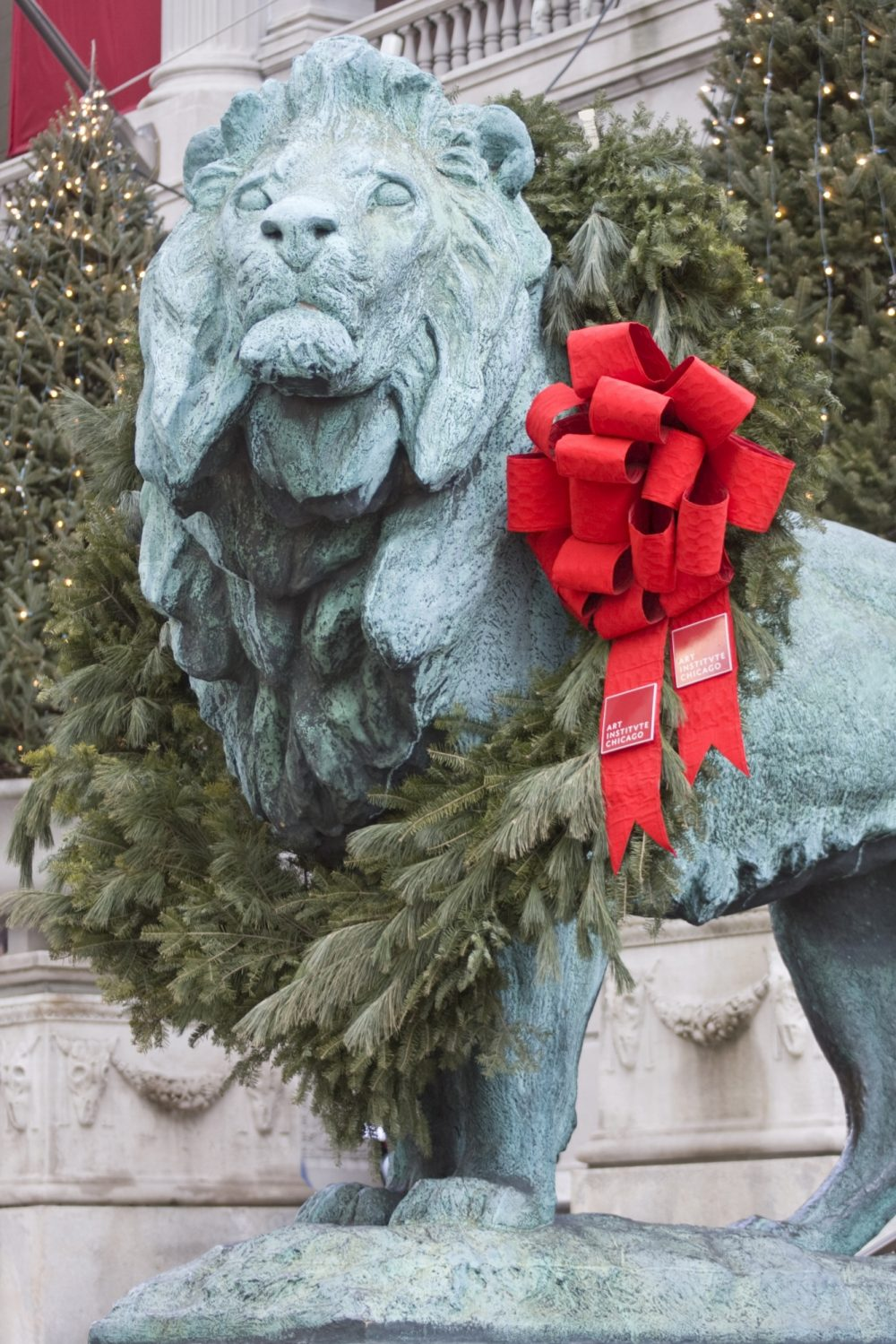 One of the lions that guards the entrance to the Art Institute of Chicago is decorated with a holiday bow.