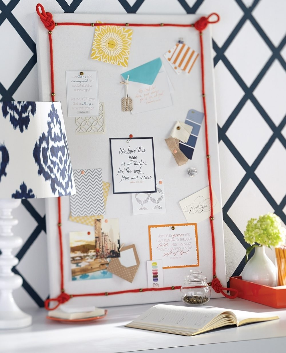 This Knot Board starts with a preframed cork board wrapped in a piece of fabric, softening the hard lines and creating a looser style. Colorful cording is hot-glued and pinned to the board with upholstery tacks. Sailor's knots are glued to the corners. Paint thumb tacks to personalize your board.