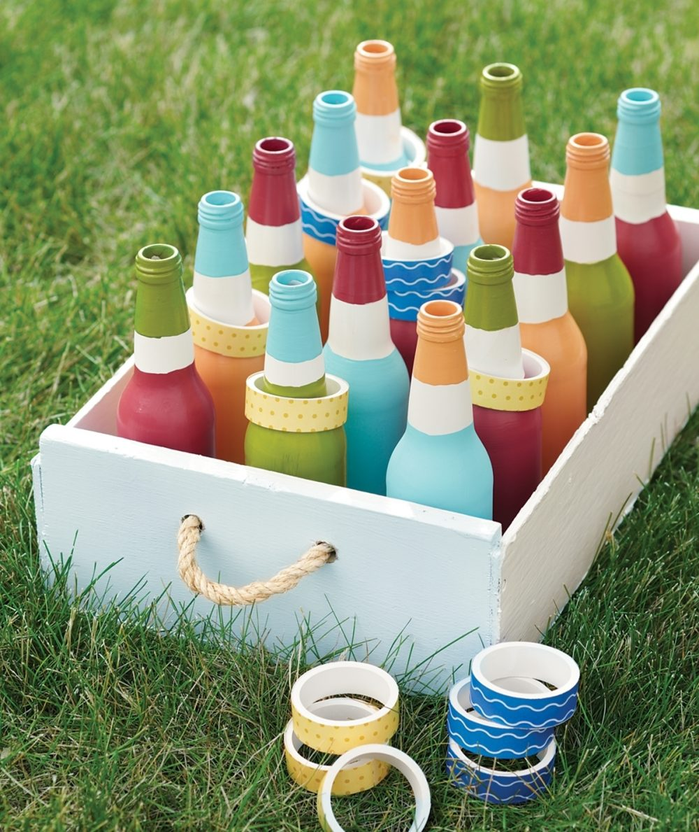 Hand-painted bottles and rings are ready for a game of Cana Ring Toss, celebrating Jesus' first miracle.