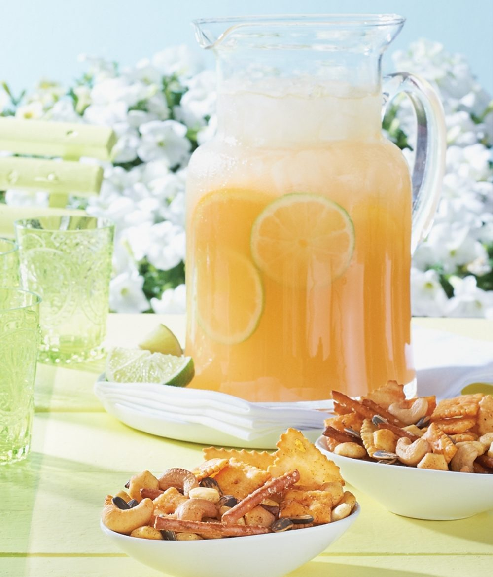Bowls of Smoky Snax are served with a pitcher of Mango-Orange Seltzer