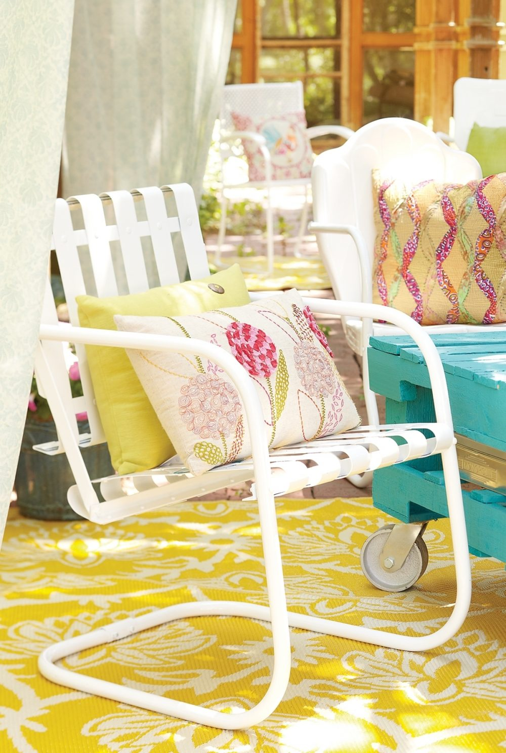 Restore weathered lawn furniture by stripping and repainting it.