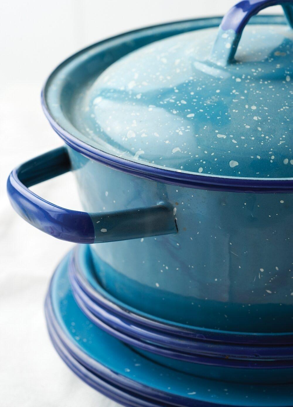 A blue enamelware pot