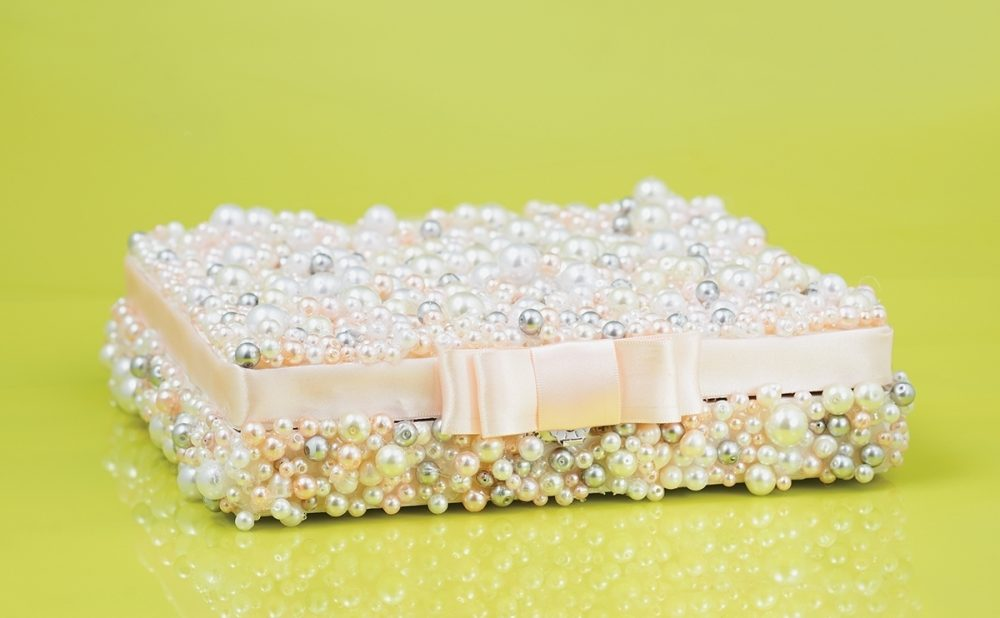 A DIY box is encrusted with imitation pearls.