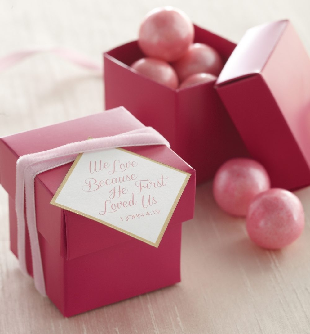 Party favors don't need to be complicated or expensive but they should give your guests a keepsake from the evening. These ring boxes with berry-hued gumballs tucked inside fit the bill. But it's the card's message that lasts the longest, letting love have the final word.