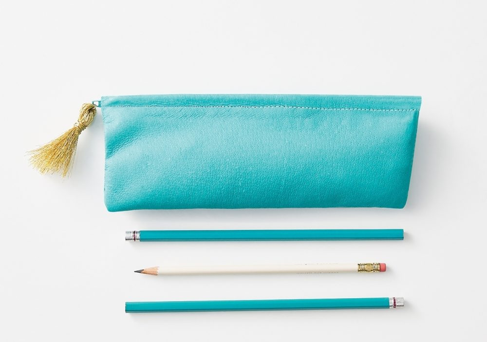 Designer case: No need to buy expensive designer bags. Make one with a large piece of leather -- available at leather specialty stores -- in aqua, shimmery gold or other colors. Each leather piece produces several pencil case or cosmetic bags in an afternoon. Add a tassle or charm to the zipper pull to give it a custom touch.